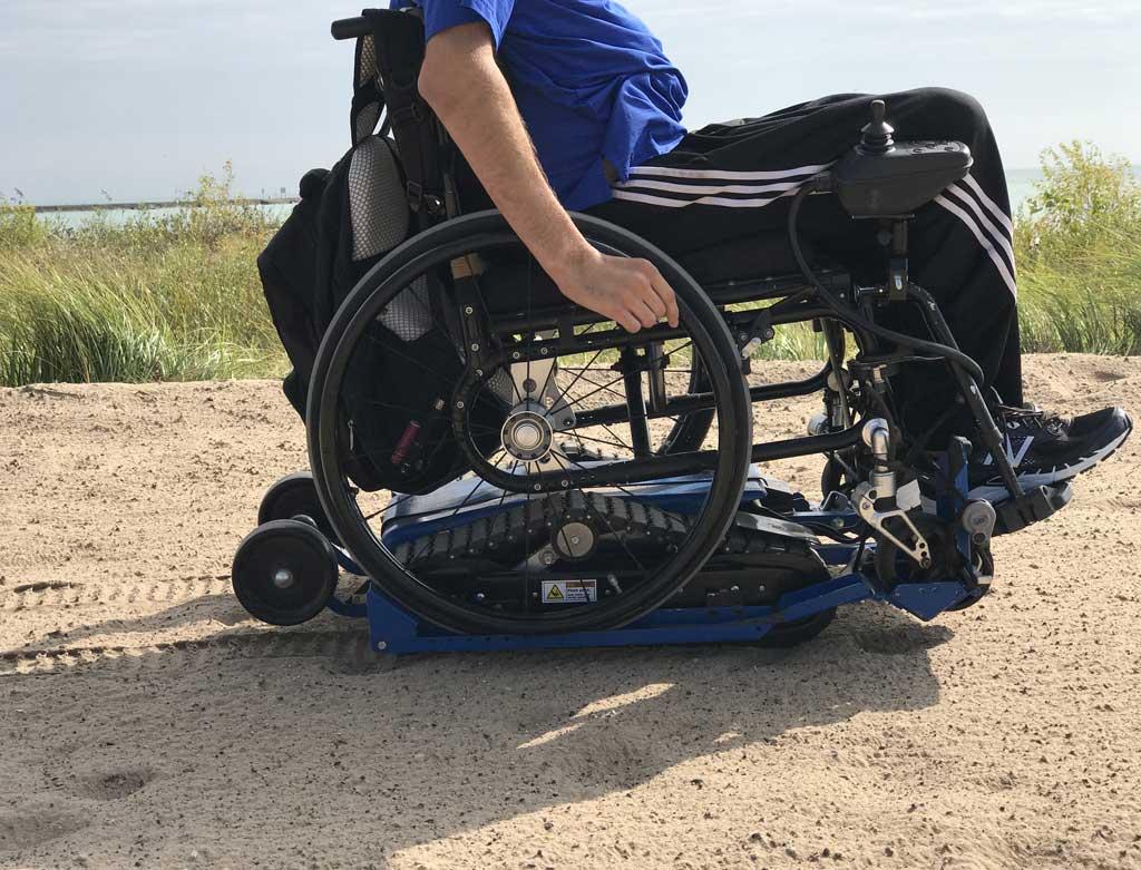 Location- de chenillette pour fauteuil roulant manuel